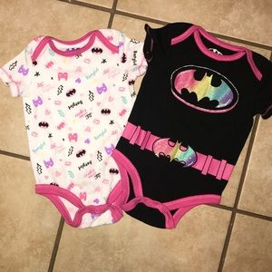 Two Batman onesies